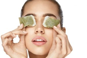 K-beauty remedies for dark circles-woman-tea bags